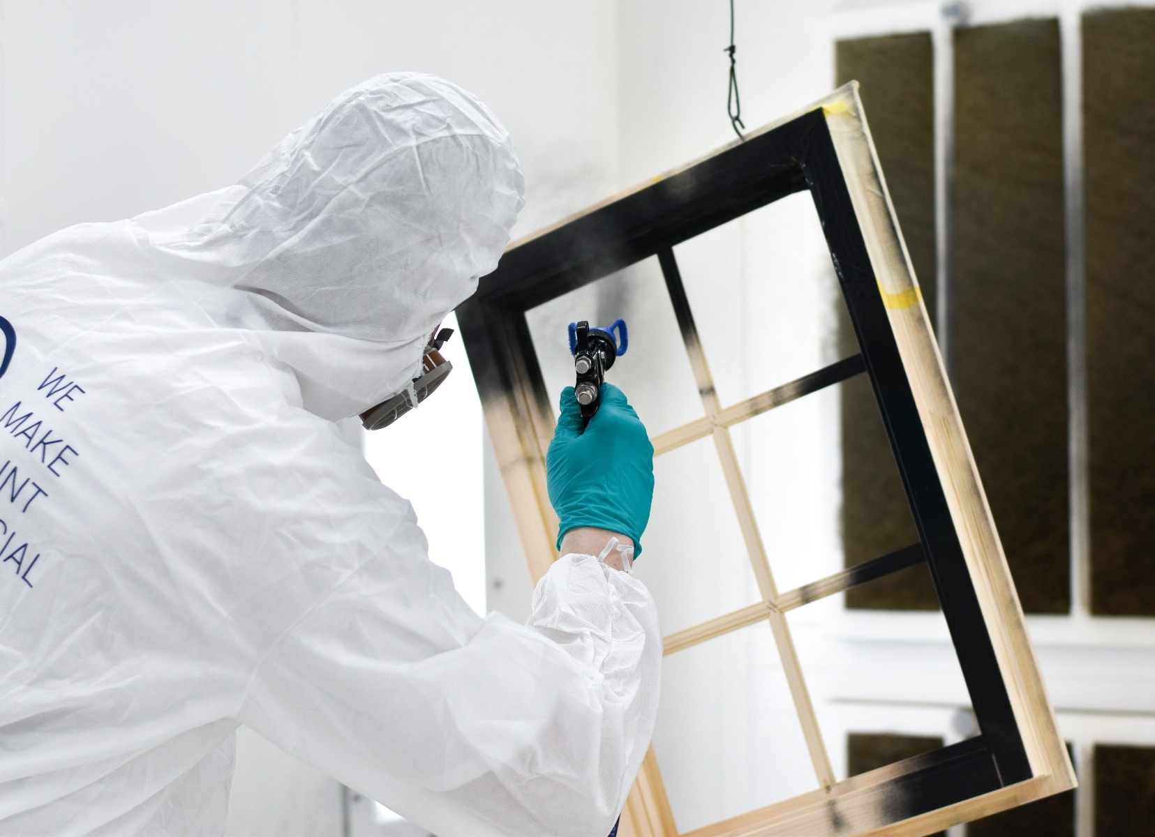 spraypainting a window frame